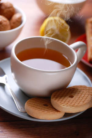 theine: hot tea with lemon on the table