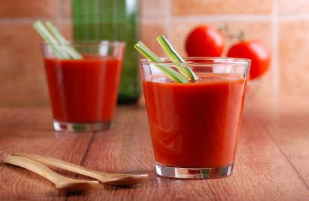 Tomato juice in glass beakers