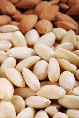 shelled: pile of shelled almonds on wooden table Stock Photo