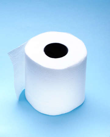 roll of white toilet paper with light blue background photo