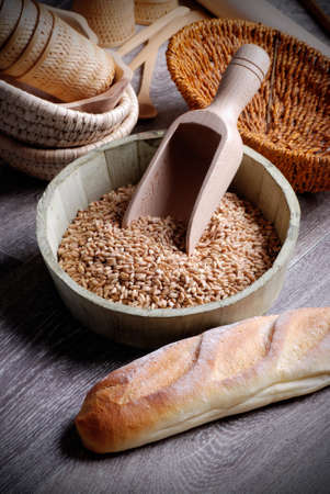 spelled bread and seeds in wooden bowl Standard-Bild