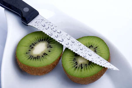 Kiwis cut with knife on white background Stock Photo - 13367439