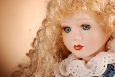 collectibles: porcelain doll with blonde hair and blue eyes Stock Photo