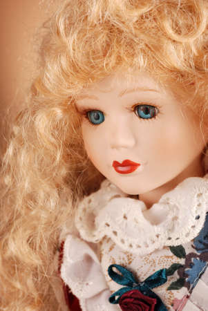 porcelain doll with blonde hair and blue eyes photo