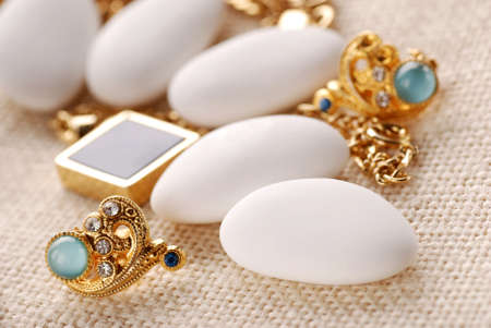 jordan almonds and gold jewelry on the table