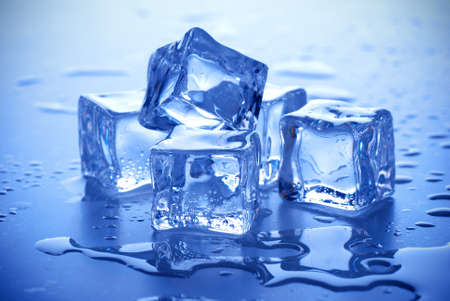 ice cube: wet ice cubes on blue background
