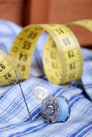 tailor measure: meters from tailoring, needle and cotton thread Stock Photo