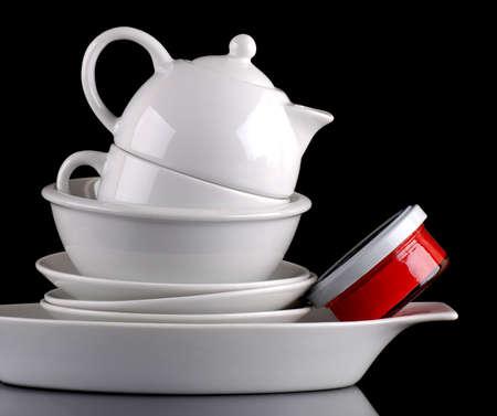 kitchen ware: white ceramic kitchen utensils on black background