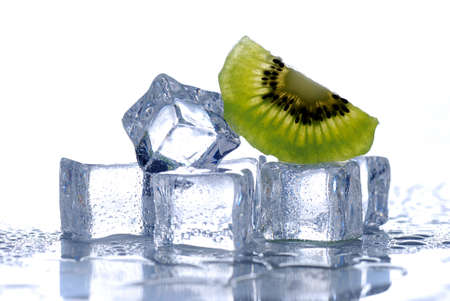 ice water: ice cubes and kiwi with a white background Stock Photo