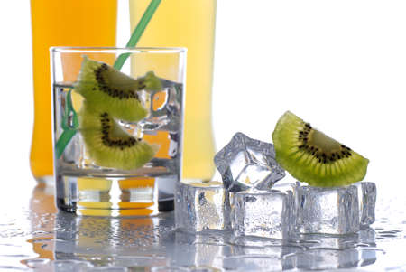 kiwi-flavored cold drink with ice cubes photo