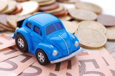 mileage: blue car and money Stock Photo