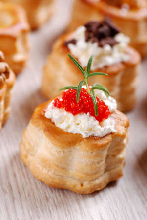 gastronomy: Vol-au-vents filled with red caviar