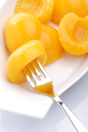 peaches in syrup on white background photo
