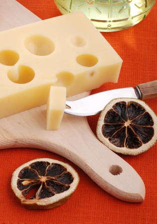 Swiss cheese on cutting board photo