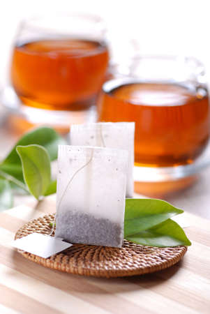 tea bags with cups in the background