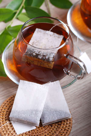 british foods: tea bags with cups in the background