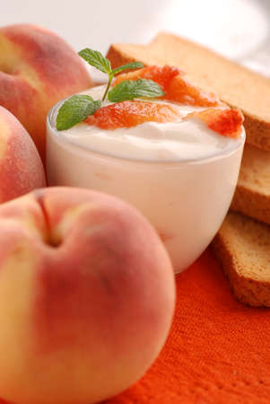 yogurt with peach flavor, decorated with mint leaves