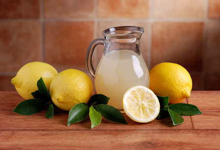 jugs: lemon juice in glass carafe Stock Photo