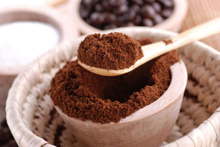 ground coffee in wooden bowl