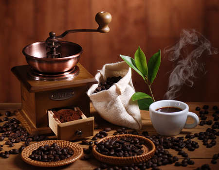 coffee grinder with coffee beans and cup of espresso photo