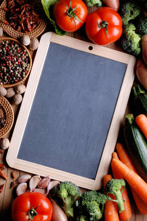 fruit vegetables: small blackboard with vegetables around