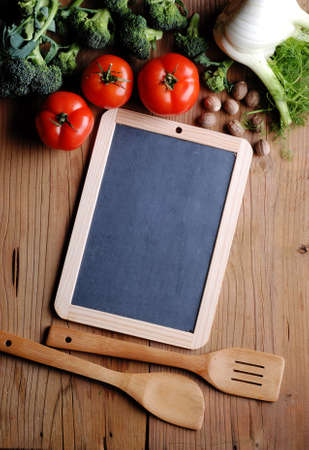 kitchen background: small blackboard with vegetables around