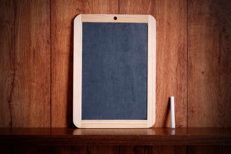 small blackboard on wooden shelf