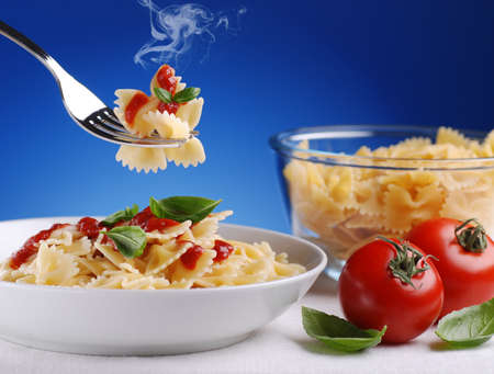smoldering: pasta with tomato sauce smoldering with blue sky background