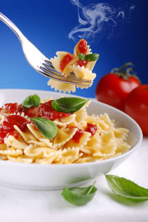 italy food: pasta with tomato sauce smoldering with blue sky background