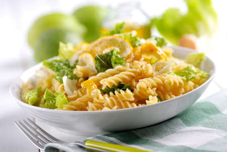 pasta salad with lettuce and lemon slices