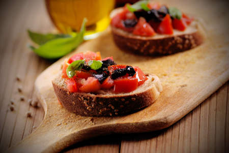 bruschetta with tomato, olives and basil