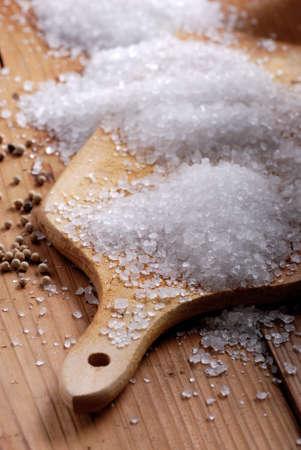 coarse: coarse salt on wooden chopping board