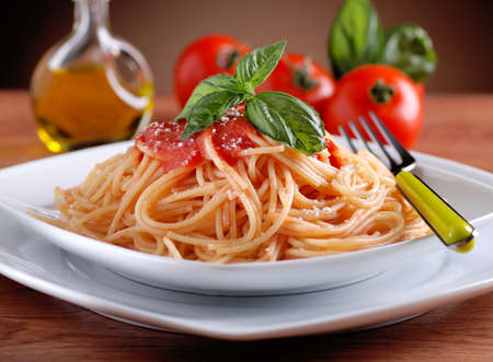 spaghetti with tomato sauce with basil leaf photo