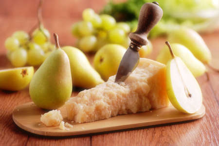 boxcutter: portion of parmesan cheese with pears around
