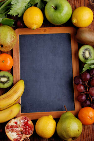 the chalkboard with fresh fruits around photo
