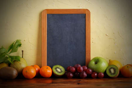 the blackboard with fresh fruit photo