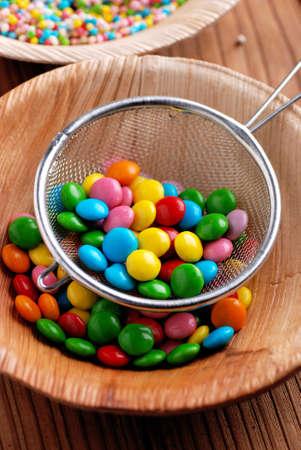 smarties: colorful smarties in metal colander