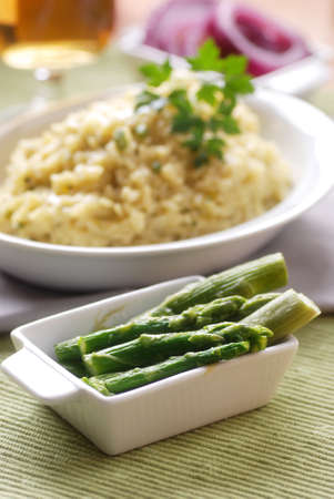asparagus risotto with ingredients around photo