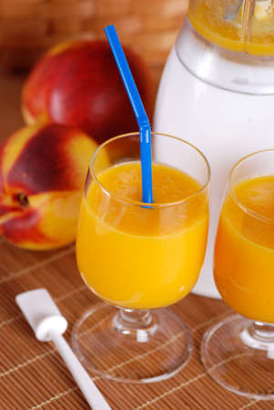 thirst quenching: peach smoothie in the glass with ingredients around Stock Photo