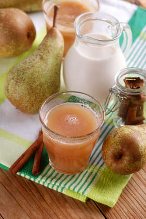 thirst quenching: pear smoothie with cinnamon in glass beaker with ingredients around