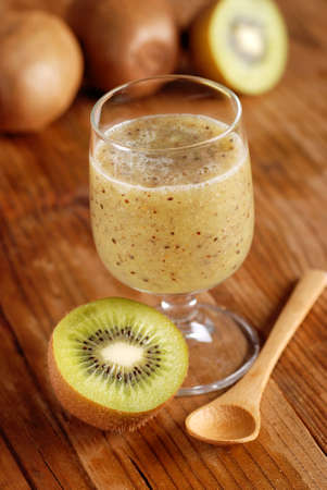 thirst quenching: kiwi smoothie in glass beaker with ingredients around