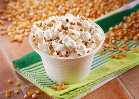 popcorn bowls: popcorn in white bowl on the table