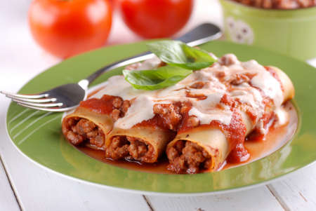 meat dish: cannelloni with meat sauce - traditional Italian recipe Stock Photo