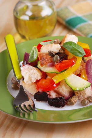 stale: panzanella - traditional Italian salad with peppers, stale bread, cucumbers, olives and capers