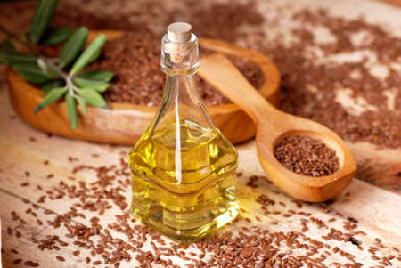linseed: essential oil of linseed in the small glass bottle Stock Photo
