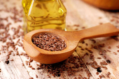 flaxseed: essential oil of linseed in the small glass bottle Stock Photo