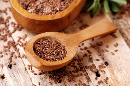 flaxseed: flax seeds in wooden spoon Stock Photo
