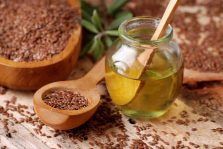 flax seeds: essential oil of linseed in the small glass bottle Stock Photo