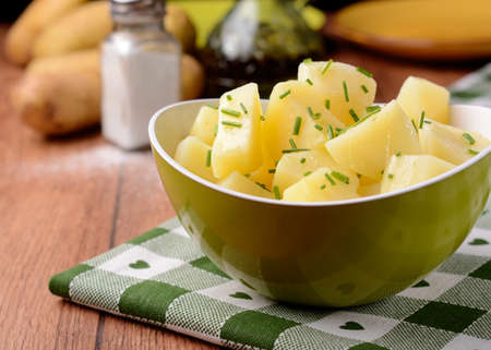 potato salad: potato salad and chives in green bowl