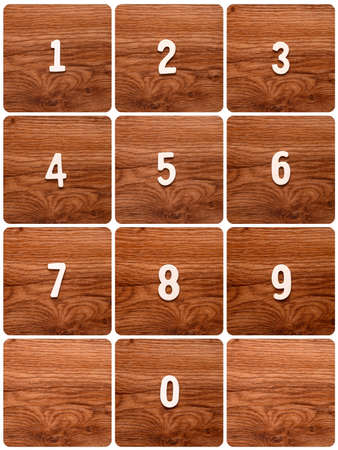 telephone keypad wooden rectangular in shape with numbers from 1 to 9 Stock Photo